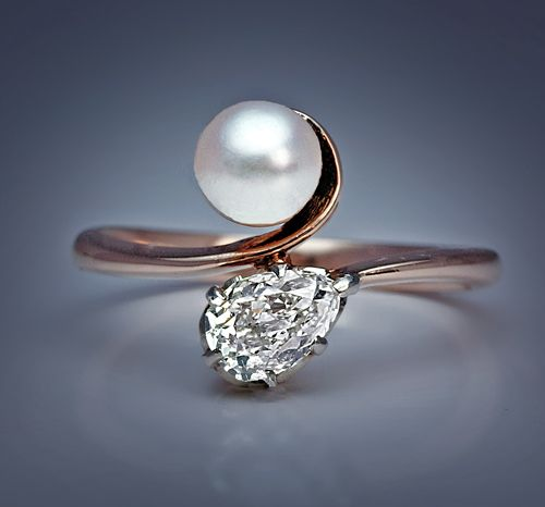 An Elegant Pearl and Diamond Bypass Engagement Ring, made in Moscow in the 1930s. A rose gold ring set with a pearl and an antique pear cut diamond.