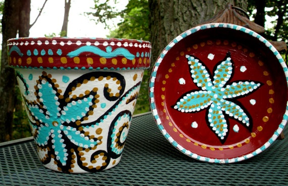 "For a wedding shower, why not have ""centers""  Guest could decorate flower pot  table favors for the wedding in your wedding colors.  (Maybe not this fancy!)"