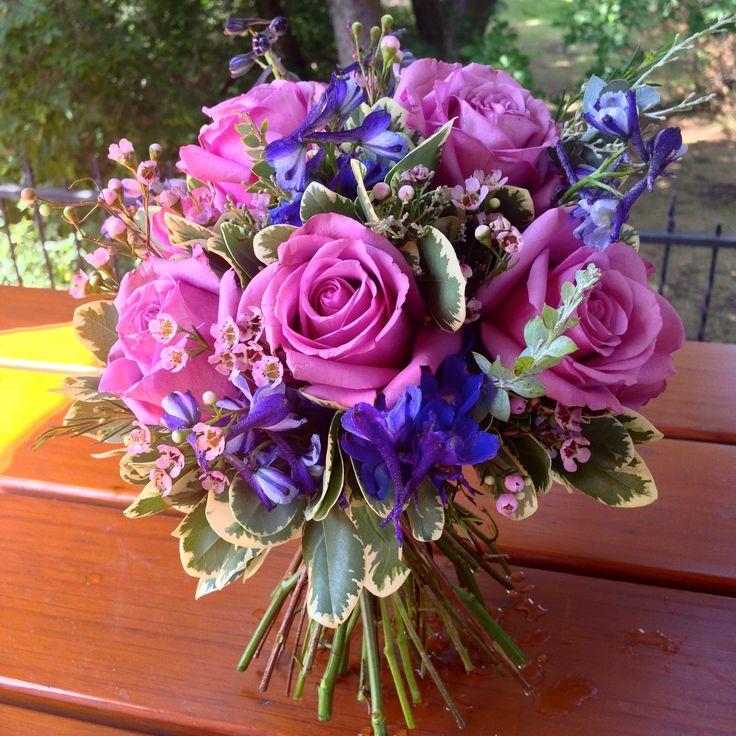 Purple hand-tied bouquet designed by Exquisite Details