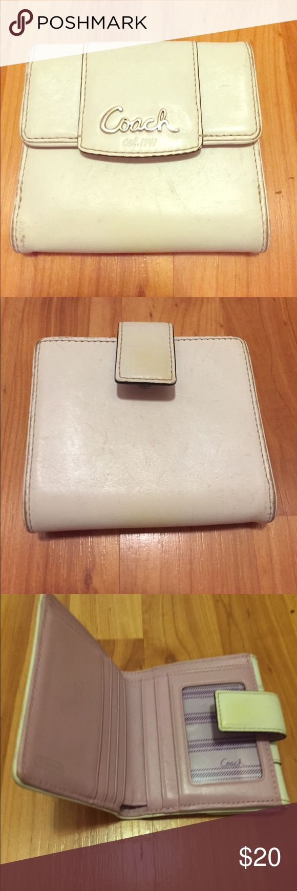 White Coach Women's Wallet White Coach women's wallet with purple interior. It's used and has a few scratches on the outside. A part of the clasp is also discolored. But the inside is in great shape. Make an offer... price is negotiable. Coach Bags Wallets