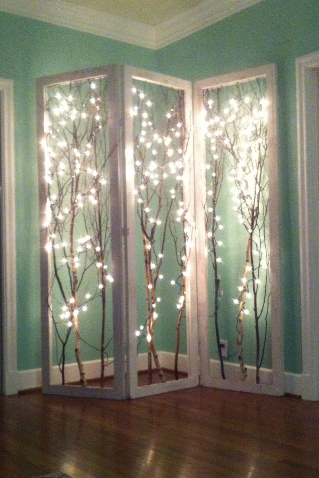 So pretty!! Just a room divider frame and branches and lights