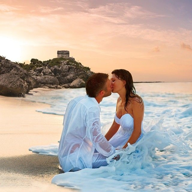 Beach wedding. Romantic kiss. Bride and groom.