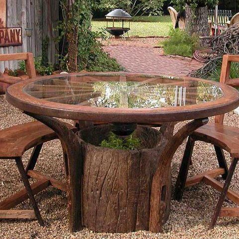 Table made from tree trunk stump, wagon wheel and glass. MUST HAVE!