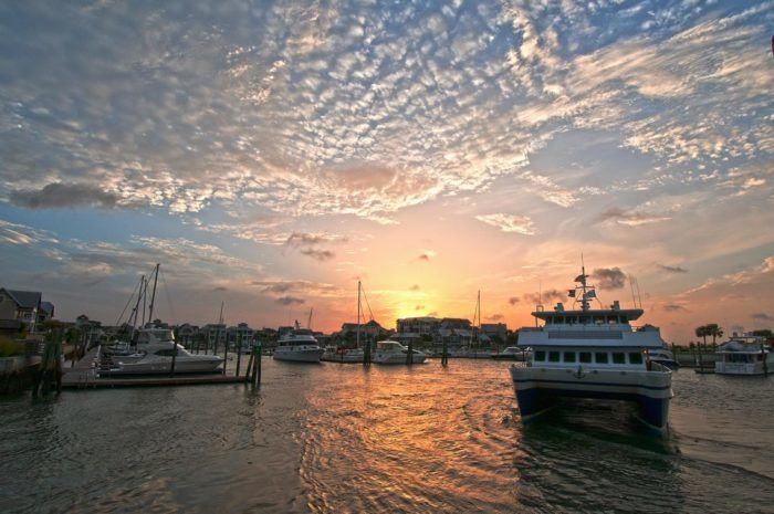 Situated on 12,000 acres, with 10,000 of those remaining untouched, Bald Head Island is a dreamy getaway and unforgettable beach day wrapped into one. To access, you can take the ferry route from Southport.