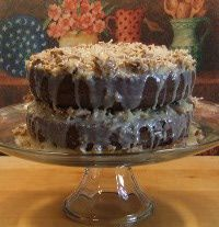 A German Chocolate Cake is a lighter version of a chocolate cake with a coconut-pecan icing.