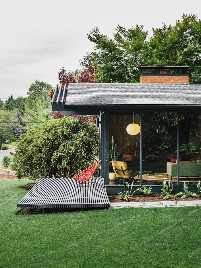 "Speaking to his original design, architect Saul Zaik says, ""We were really just building boxes with a bunch of windows but experimenting with how you integrated indoor and outdoor spaces."" The house has seven different openings to the exterior, allowing different courtyard or patio settings for a range of outdoor activities, including seating for a gathering on the street-facing side. The Milfords hired Lilyvilla Gardens for the landscaping around the house, including variegated bluestone…"