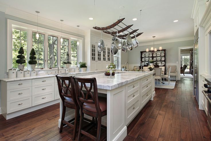 Impressive Sherwin Williams Sea Salt fashion Other Metro Traditional Kitchen Remodeling ideas with crown molding glass cabinets hanging pot rack large kitchen island light blue walls Marble