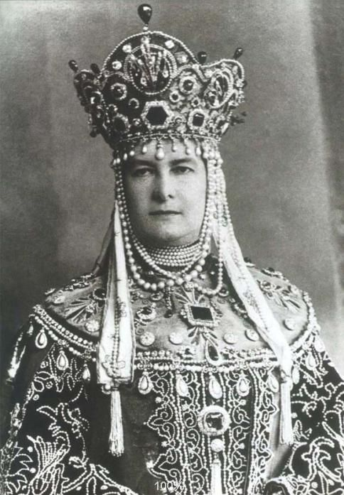Grand Duchess Maria Pavlovna wearing a traditional russian dress, covered with emeralds, diamonds, and pearls. The largest emerald once belonged to Catherine The Great: