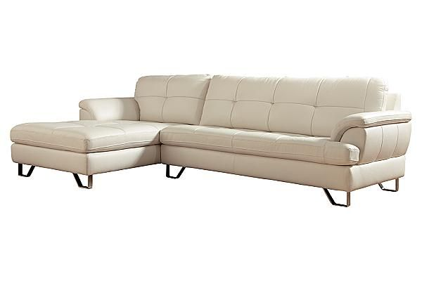 The Gunter - Brilliant White Sectional from Ashley Furniture HomeStore (AFHS.com). Upholstery features top-grain leather in the seating areas with skillfully matched DuraBlend® upholstery everywhere else.