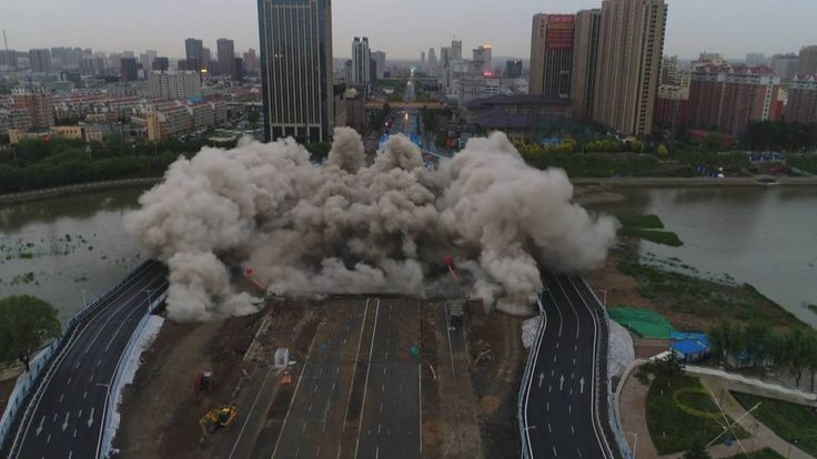 The surface of a bridge was demolished in a blast in northeast China's city of Changchun. The piers remained intact for a new bridge floor.