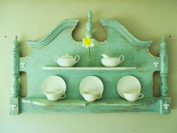 Turn an old headboard into a unique display shelf