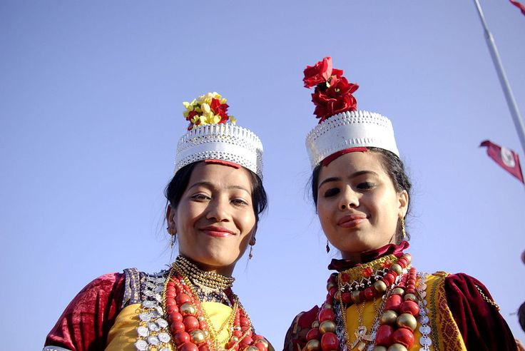Khasi girls in traditional dress. The tribe in India is matrilineal andmatrilocal, which means that childrenlive with the mother's side of the family or clan.