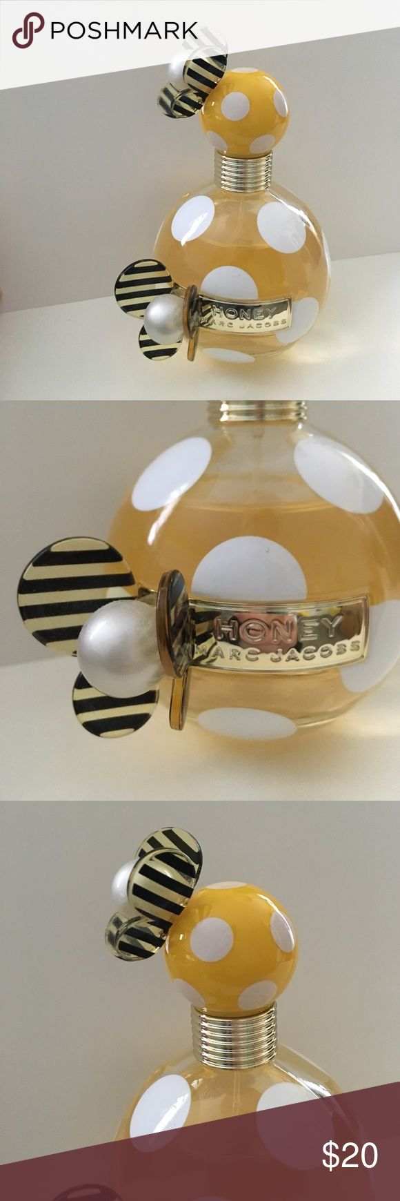 Marc Jacobs Honey Perfume This is the 3.4 OZ, 100 ML size bottle. This has been used a few times, but the bottle is more than 3/4 full. Simply selling it because I don't use it anymore and don't want it to go to waste. It's a sunny floral scent and comes in a beautiful bottle. Original box NOT included. Marc Jacobs Makeup