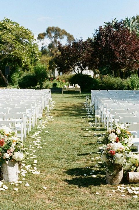 Like the idea of putting flowers on tree stumps at the entrance and/or along the aisle