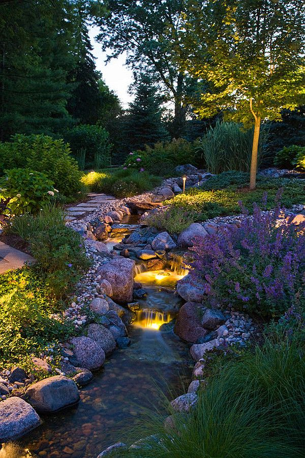 Beautiful garden and water feature!  Love this photo and it's night lighting in a garden too.  Just the right touch of flowers and landscaping!