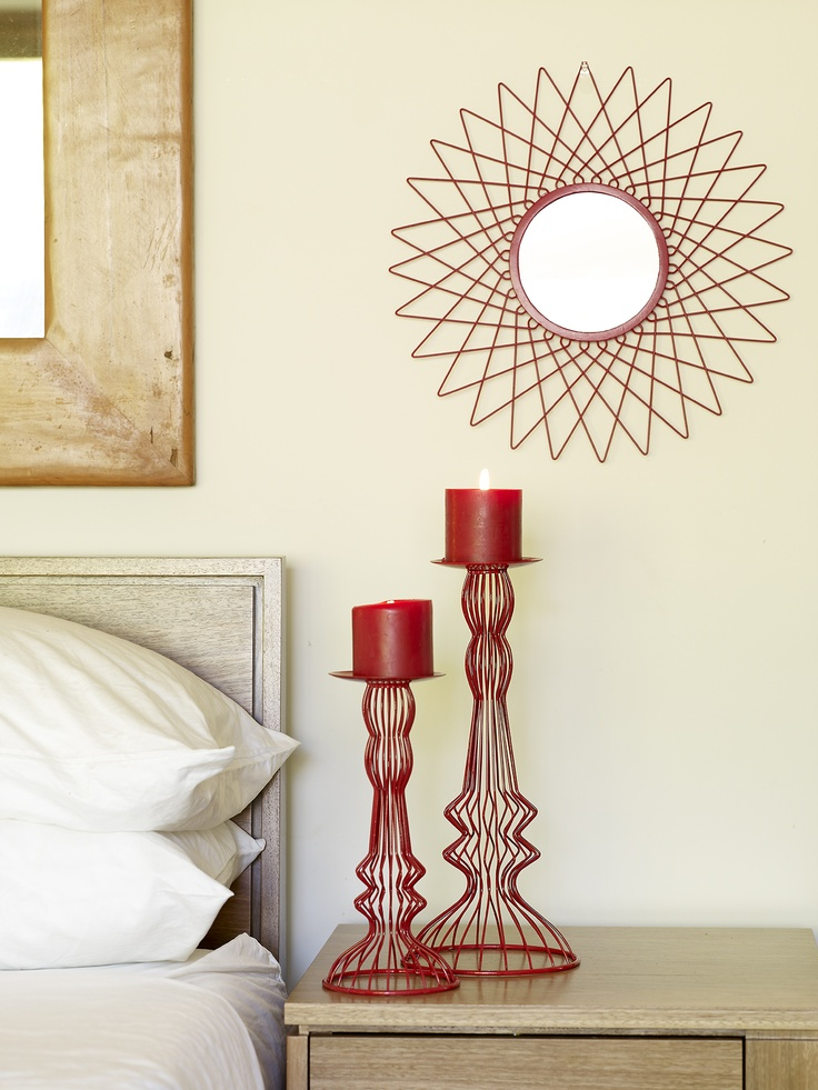 We LOVE metal! Zoltan mirror & Skara candle holders in rich red.