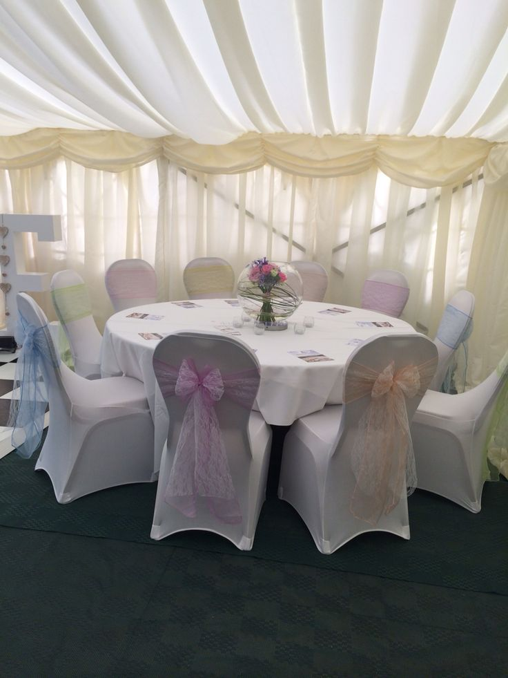 Pastel shades and lace chair sashes. With white arch front chair covers  www.lakelandevents.co.uk