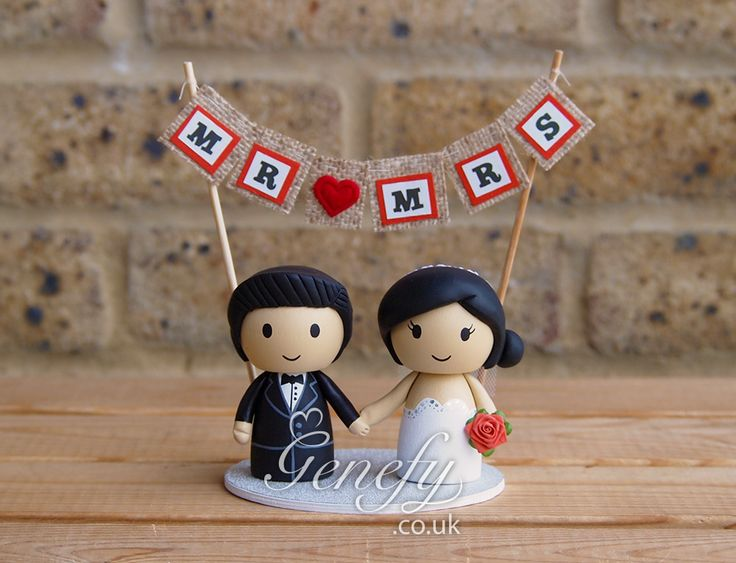 Bride and groom with Mr and Mrs banner wedding cake topper by Genefy Playground.  https://www.facebook.com/genefyplayground