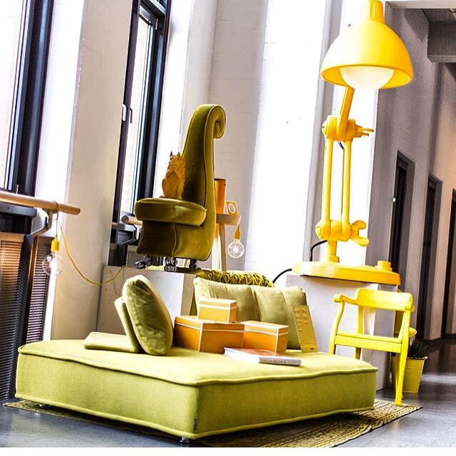 A lovely picture of the yellow lamp called Lummel in a beautiful setting in Hamburg. (Stilwerk)
