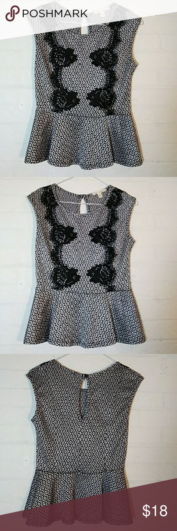 Black and White Peplum Top by Miami Black white geometric peplum top with black floral lace overlay. miami Tops Blouses