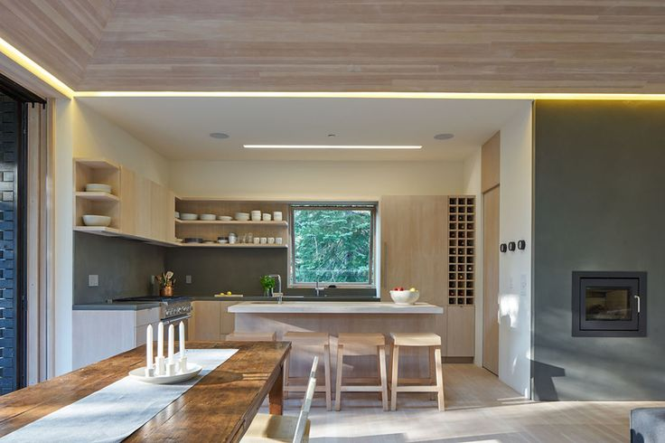 The open-plan kitchen serves the family's needs for easy entertaining. The four bar stools are also custom designed by Lexie and were built by Yvonne Mouser.