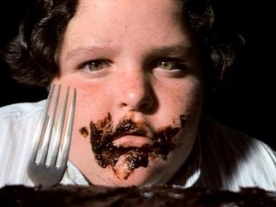 fat kid who eats the whole chocolate cake in Matlida....XD ...