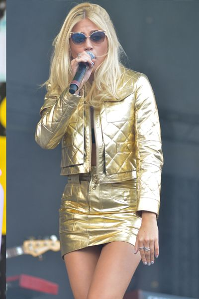 Pixie Lott in quilted gold mini skirt and jacket on stage at V Festival 2014
