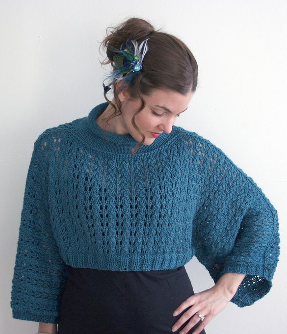 Free Knitting Pattern for Harper Poncho - A cropped cowl-necked lace poncho with buttons to create sleeves. Designed by Katie Rose Pryal. Worsted weight. The original pattern includes a front kangaroo pocket that the pictured projectby yarnmonster omitted.