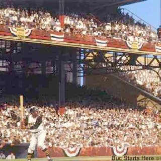 Roberto Clemente of the Pirates at bat at Forbes Field  for the first game of World Series with Yankees.