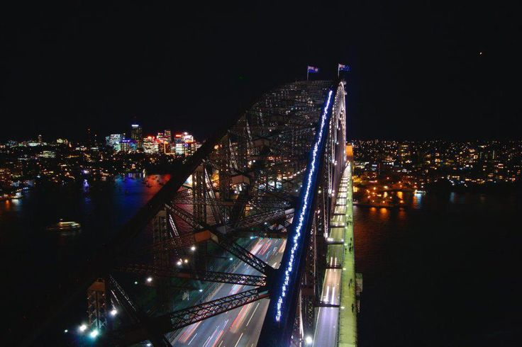 130 climbers on top of the Harbour Bridge turn it on for the opening night of Vivid Sydney - BridgeClimb Sydney