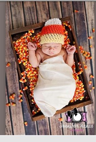 Halloween newborn picture but do this with candy hearts instead in Feb.