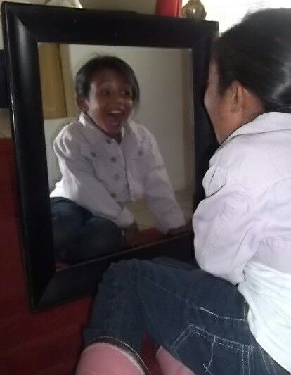 Looking at herself in the mirror