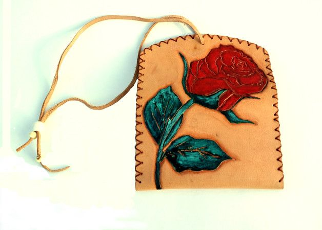 Unique engraved tobacco bag for women from real leather that will last forever,with painted rose engrave. With exterior pocket for rolling papers. Dimensions:15cm*9,50cm