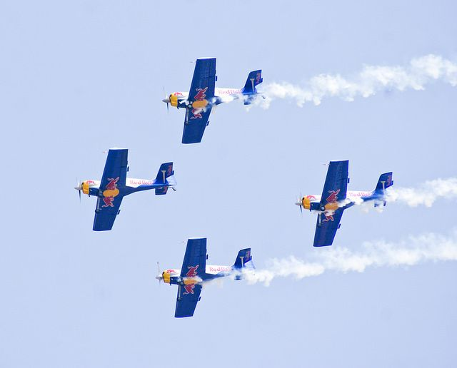 Red Bull aerobatic team in a formation.