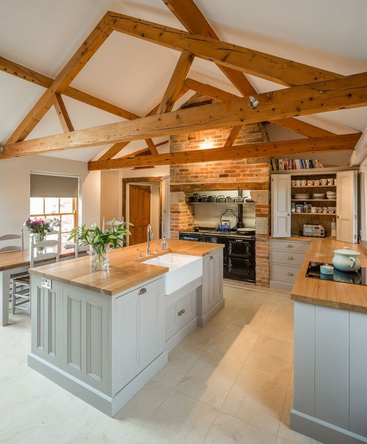 Exposed roof truss kitchen farmhouse with exposed wooden beams country kitchen wooden dining table cup bin pulls