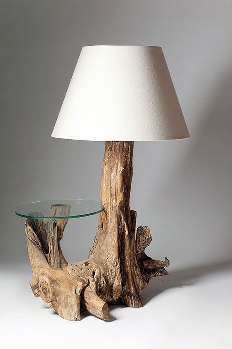 a drift wood art piece of lamp and table