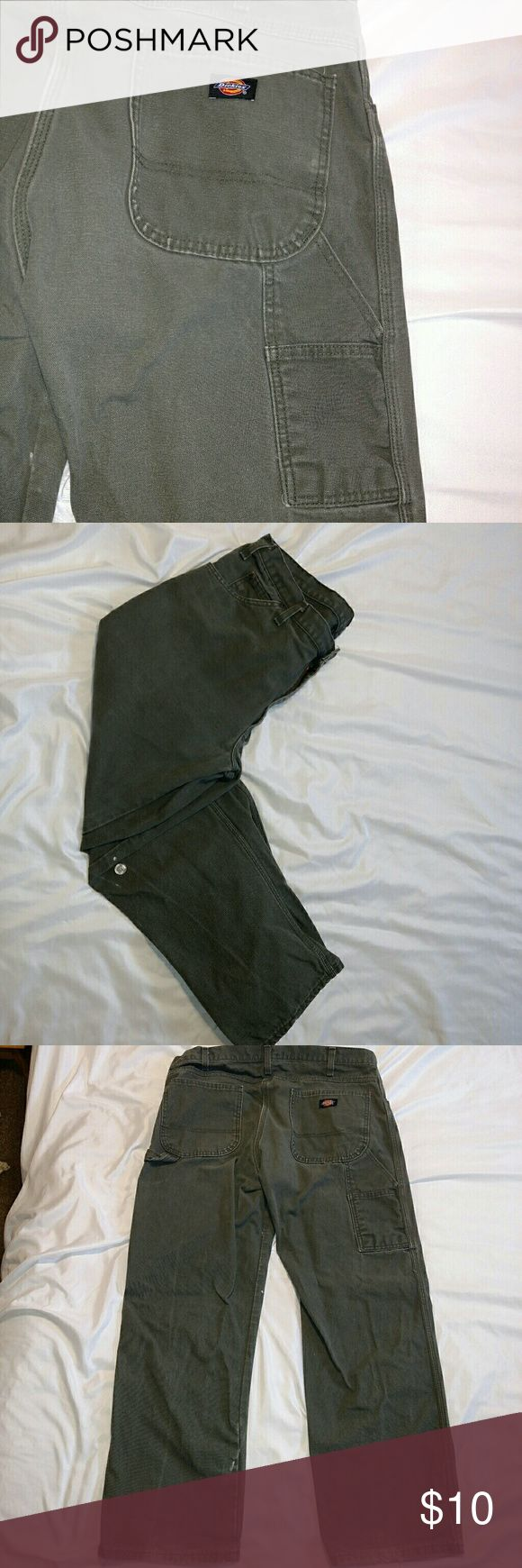 Dickies cargo pants GUC. Still have a lot of wear left in them. Some small paint spots as shown in pics and wear at bottom hem near heels. Dickies Pants Cargo