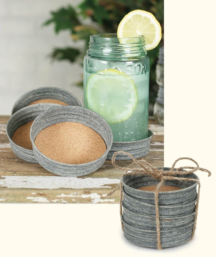 """Set of 4-3¾"""" dia. and 1"""" tall. Features cork inside to absorb moisture. Comes as shown, with an attractive jute tie. Lids will fit a wide-mouth Mason jar. Maso"""