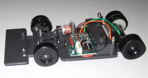Magracing chassis is 1/32 scale, power is one AAA lithium ion cell located from underneath the chassis and held in place by magnets for quick replacement.