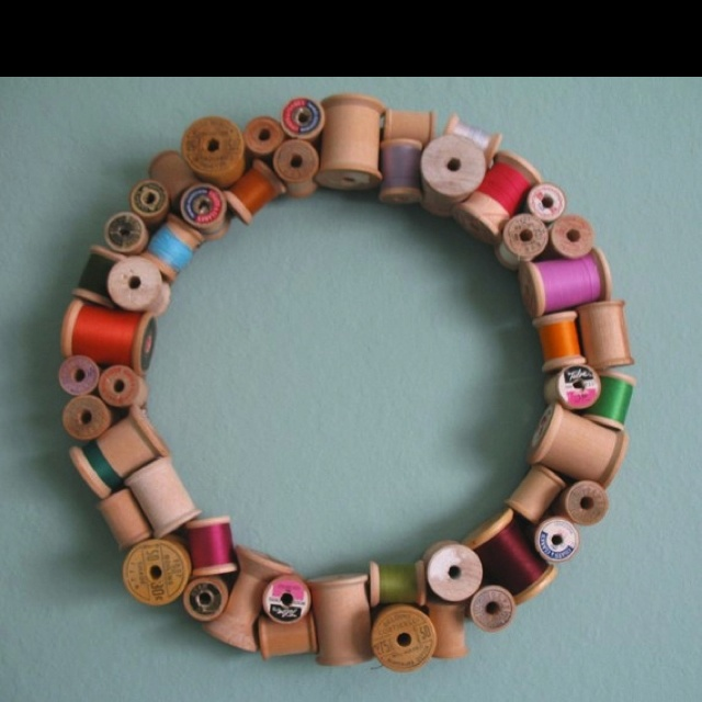 Wooden spool wreath from craft magazine. Like this; a bit