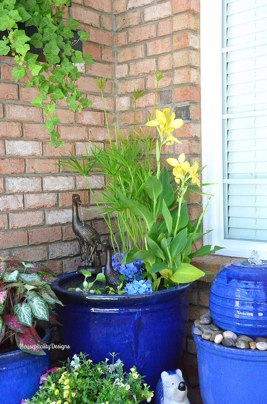 Garden container pond fountain housepitality designs for Pot water fountain designs
