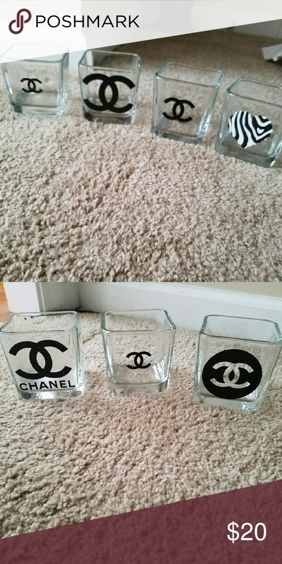 Handmade Chanel glass vase. These beautiful handmade vase or any purpose you may choose will add class to any use. The glass is solid and heavy. Use as candle holders, makeup brushes holder or anything you choose. 1 for 10. 2 for 16. 3 for 24. CHANEL Other