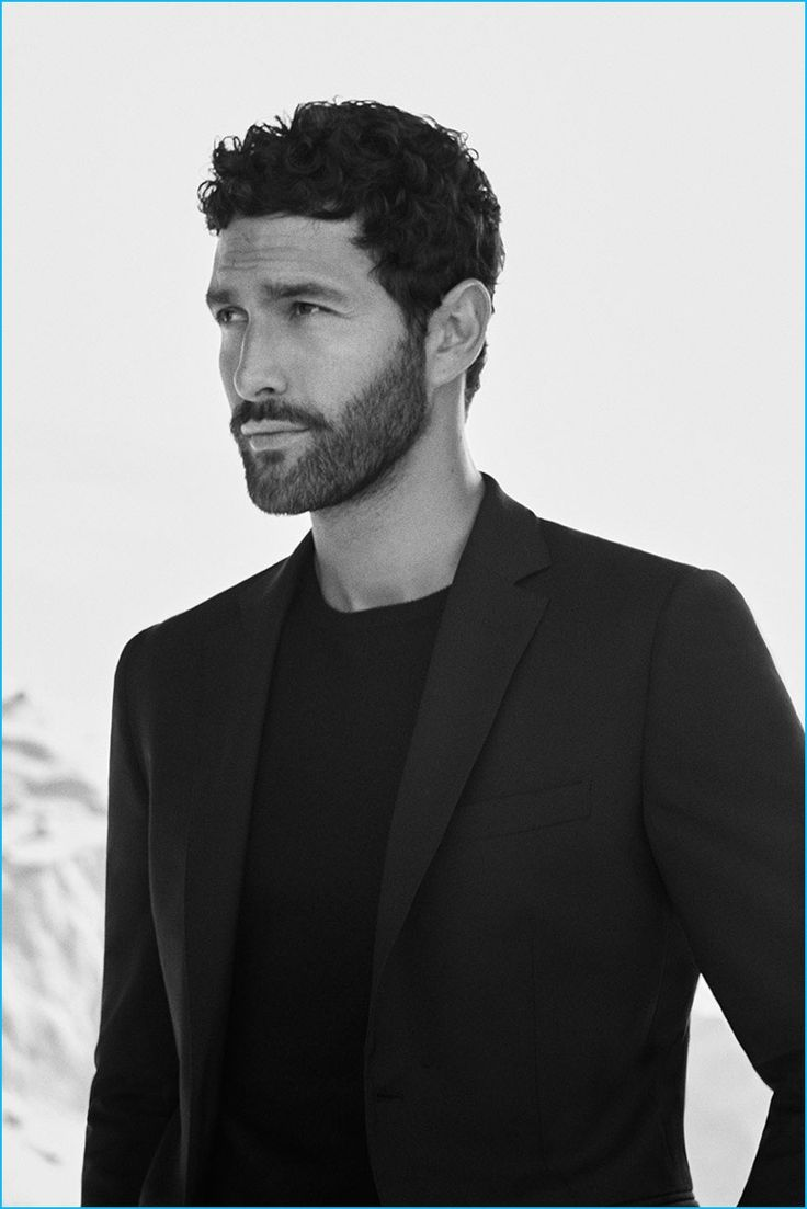Model Noah Mills is front and center in a sweater and sport coat from Massimo Dutti.