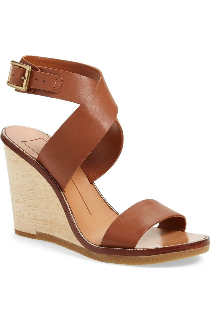 Totally in love with these lofty wedge sandals from Dolce Vita. The casual sophistication of an open-toe silhouette is topped with a wide crossover ankle strap.
