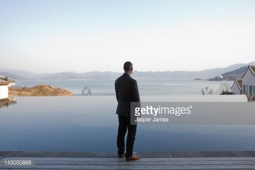Stock Photo : man looking out to lake in ningbo,china