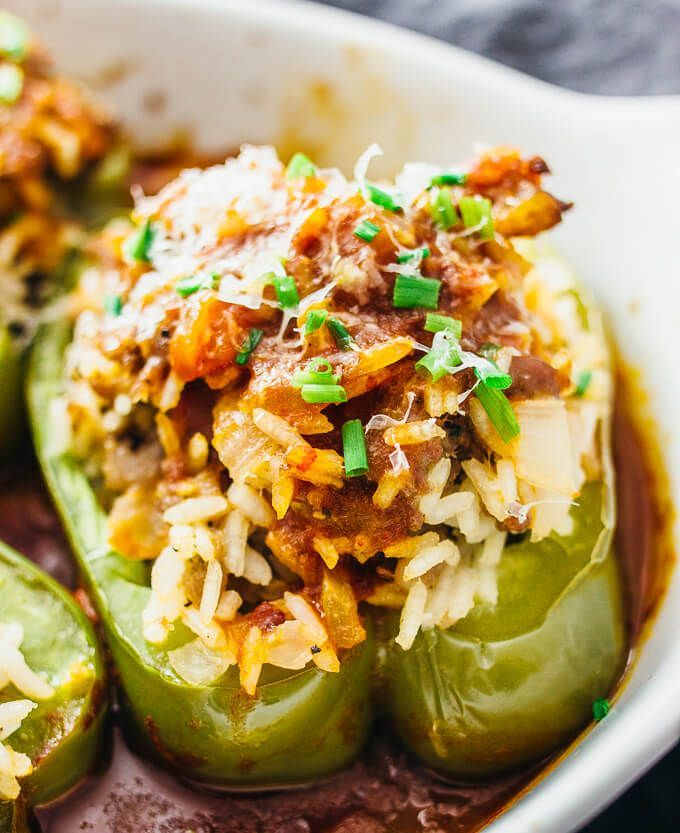 Best recipe for Italian stuffed peppers that are loaded with sweet Italian sausage and rice, and paired with a slightly spicy balsamic tomato sauce.