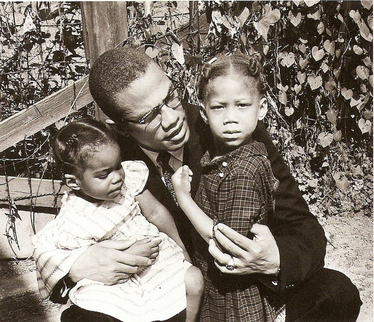 Malcolm X with his daughters Attallah and Qubilah
