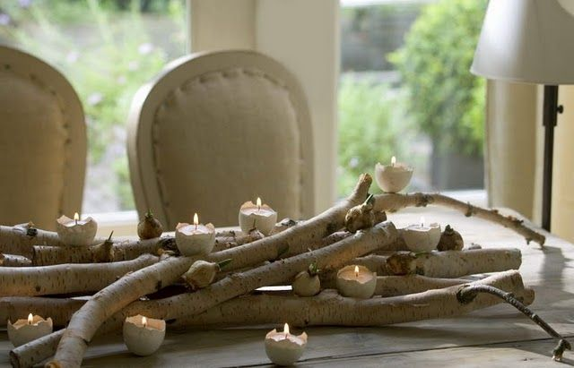 Lovely Table Setting with Birch Branches and Tea Lights from Halved Egg Shells