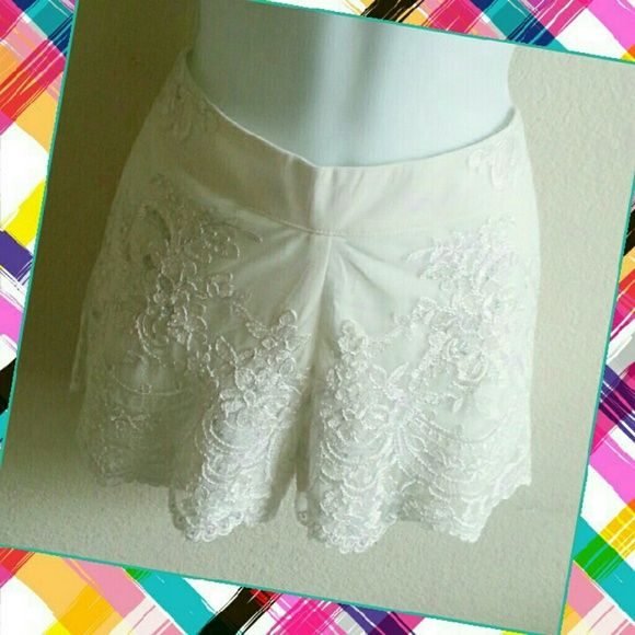 """NWT! FATE Embroidered Cream Shorts NWT! BEAUTIFUL embroidered,  cream shorts by Fate! Yummy! Zipper in back! Great detail! Clear sequins adds just the right shimmer effect! Waistline is 30"""" inches / Length is 11"""" inches. Please use the offer button for all offers. Feel free to bundle for a 10% discount. No trades, ladies. Fate Shorts"""