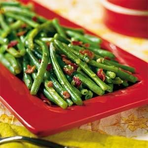 Sauté lightly steamed green beans and top with chopped bacon and green onions for a simple and savory side dish.